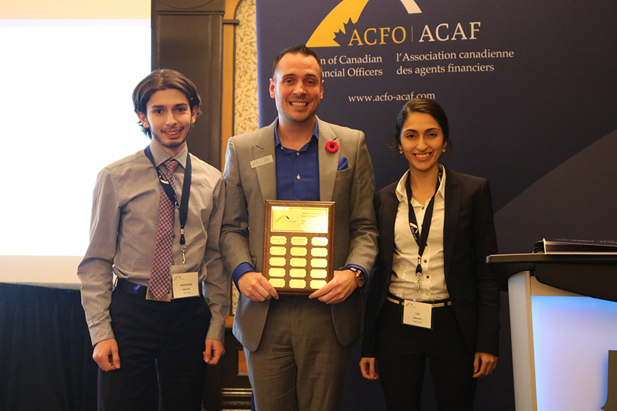 ACFO-ACAF President Dany Richard stands with two past scholarship winners